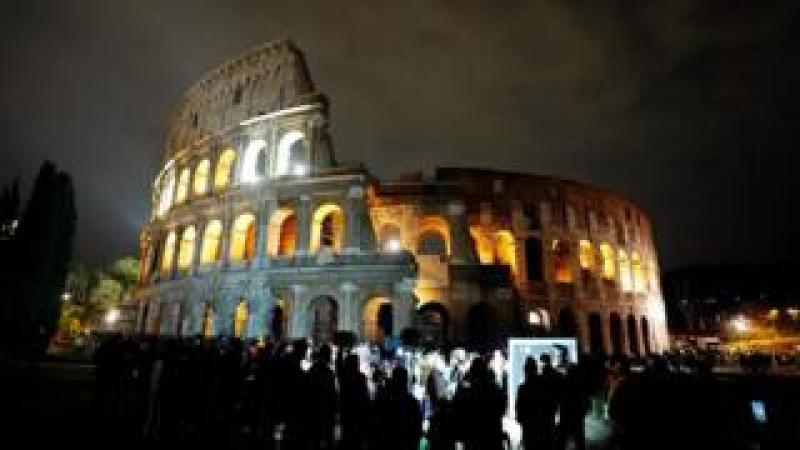 A picture taken on March 24, 2018 shows the ancient Colosseum normal lighted during the Earth Hour initiative in Rome.