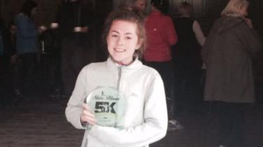 Katie Cooke with a running trophy
