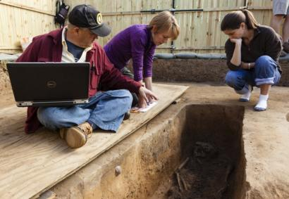 Forensic anthropologist examine the grave of Rev Robert Hunt