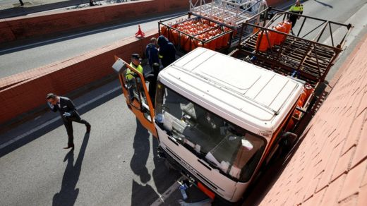 Police at the scene of an incident involving a gas cylinder delivery truck that had been stolen and driven the wrong way along a highway in Barcelona, Spain, 21 February 2017