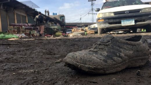 A lone shoe is seen covered in mud, among other debris, a the site of the bomb blast in Parachinar on Saturday