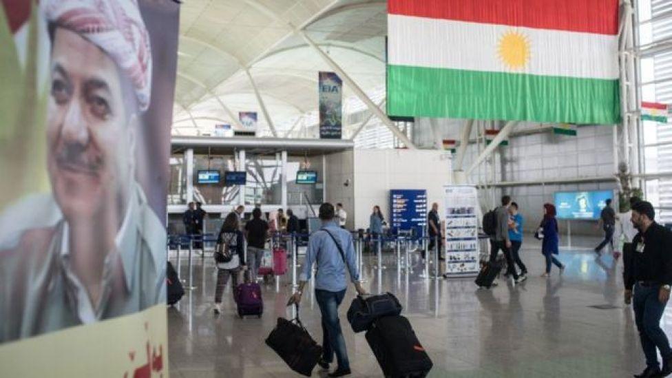 People are seen inside Irbil International Airport on 27 September 2017