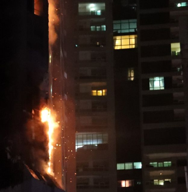 Flames shoot up the Torch Tower in Dubai