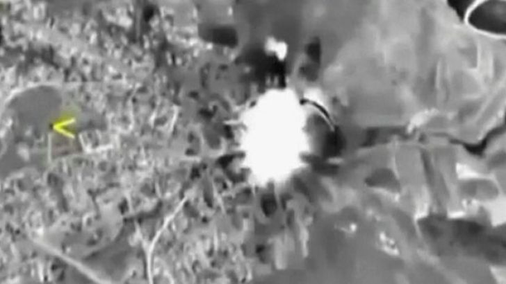 A frame grab taken from video released by the Russian Defence Ministry October 1, 2015, shows Russian jets hitting a target in Syria