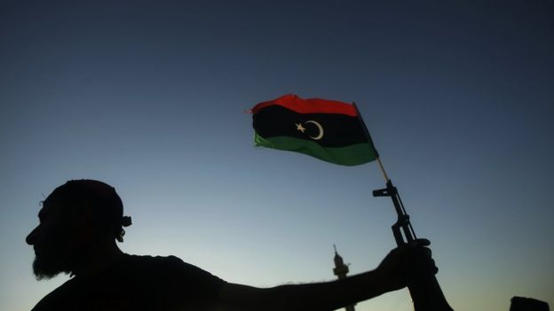Libyan rebel with gun and flag
