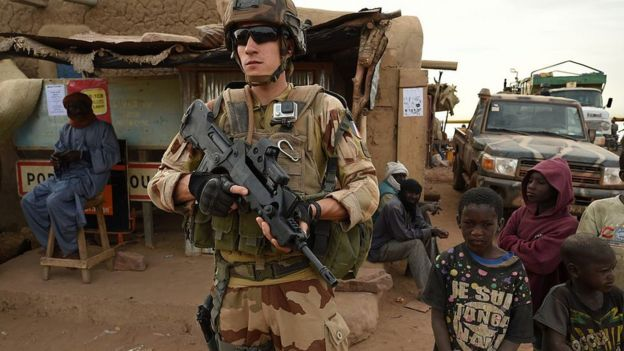 French soldier, surrounded by children in Mali.