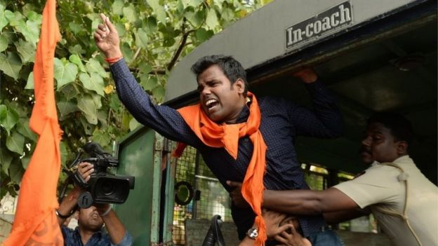 An Indian activist shouts slogans as he is detained by police outside the home of Bollywood actor Aamir Khan in Mumbai on November 24, 2015.