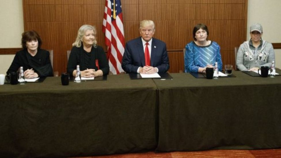 Donald Trump, centre, sits with, from right, Paula Jones, Kathy Shelton, Juanita Broaddrick, and Kathleen Willey
