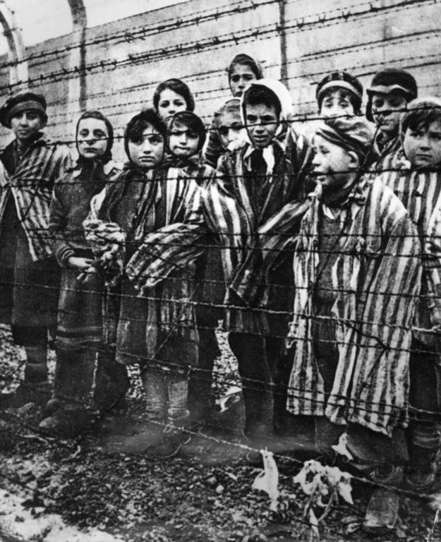 A group of child survivors at Auschwitz-Birkenau on the day of the camp's liberation by the Red Army, 27 January 1945