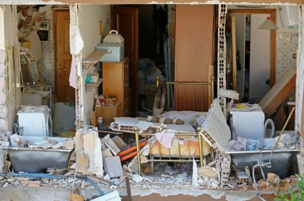 Home exposed by quake in Amatrice, 25 Aug 16