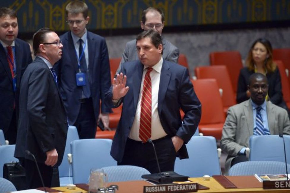 Russia's deputy UN ambassador, Vladimir Safronkov, arrives for a United Nations Security Council meeting on Syria, at the UN headquarters in New York, 7 April