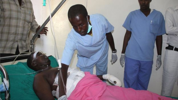 Abdirizack Jama Elmi, a journalist working for a Somali Channel, lays wounded in hospital