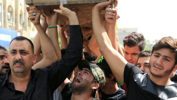 A bomb victim's funeral in Baghdad, 5 July