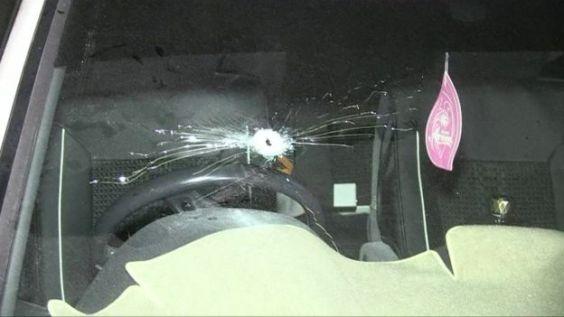 Car with bullet hole