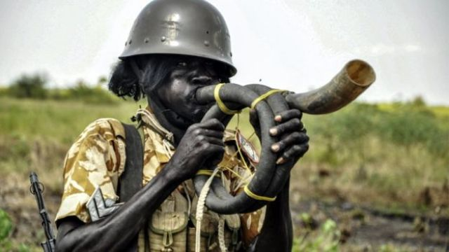 A soldier blowing a horn during a military operation in Eastern Nile State, South Sudan - Sunday 16 October 2016