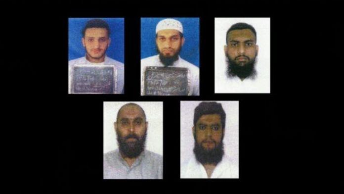 Fotos de los cinco sospechosos del asesinato que fueron absueltos este año, aunque siguen detenidos.