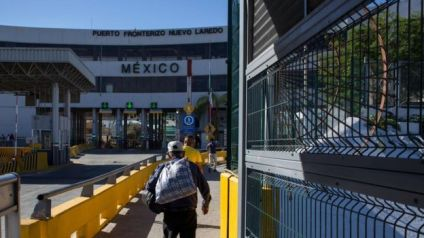 A man walks to Mexico after crossing the international bridge on the US/Mexico border in Nuevo Laredo