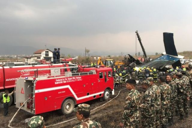 Wreckage of the plane at Kathmandu airport, Nepal, 12 March 2018