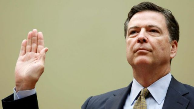 FBI Director James Comey is sworn in before testifying at a House Oversight and Government Reform Committee on the