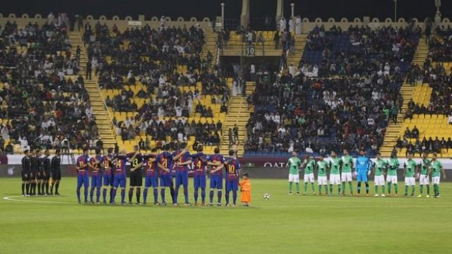 Teams observe one minute of silence during the Qatar Airways Cup match between FC Barcelona and Al-Ahli Saudi FC on 13 December 2016 in Doha, Qatar