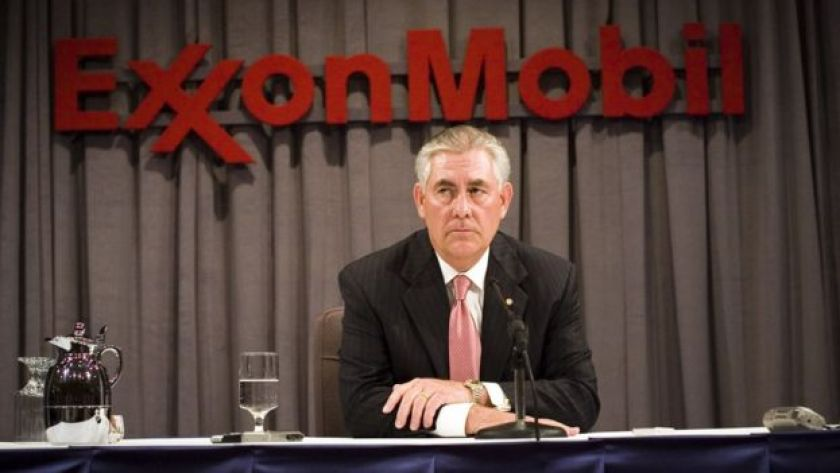 ExxonMobil head Rex Tillerson sits at a shareholder meeting in Dallas.