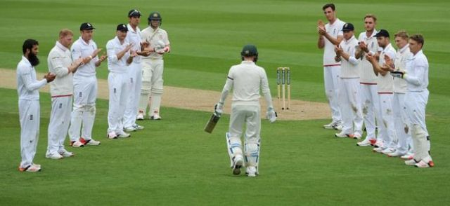 England players form a guard of honour as Michael Clarke walks out to bat in his final Test