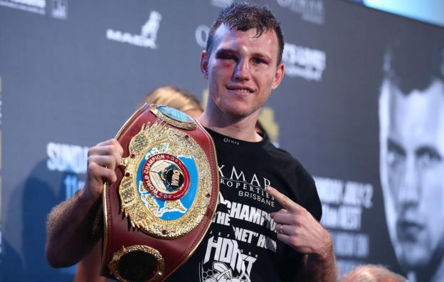 Jeff Horn points to a belt saying 'world champion' following the bout