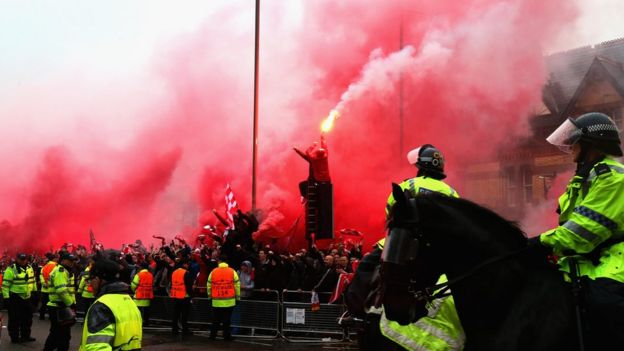Liverpool fans using flares outside Anfield