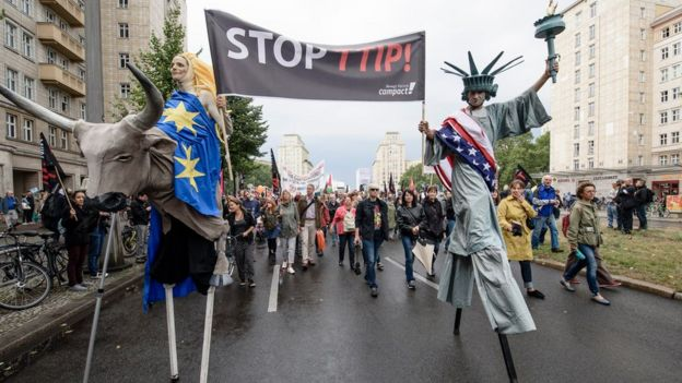 Protesters dressed as America and Europe march to demonstrate against the TTIP and CETA free trade agreements on September 17, 2016 in Berlin, Germany.