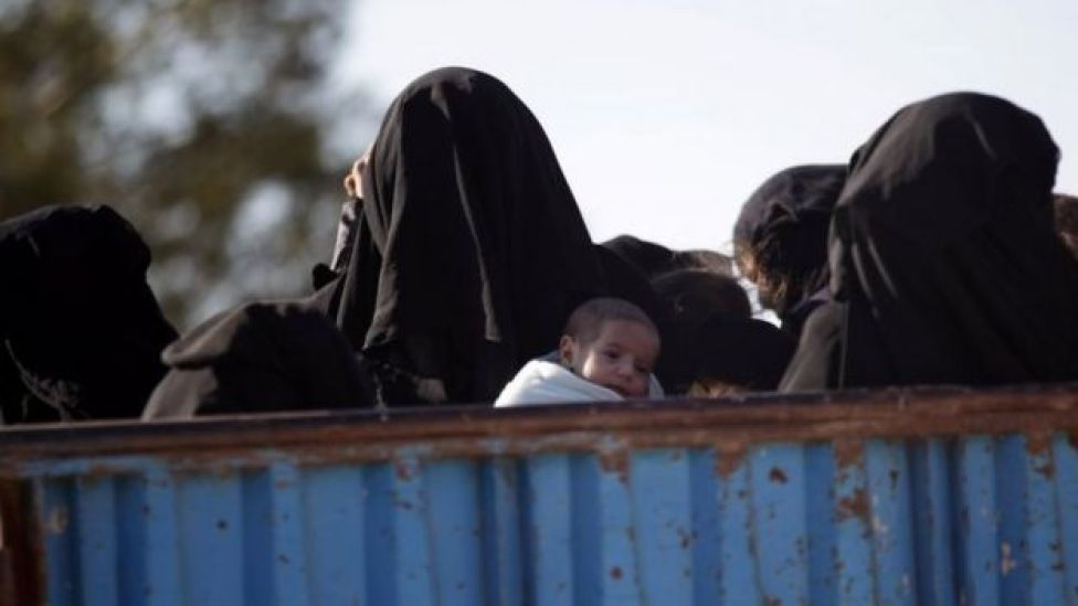 A woman, who fled the violence from Islamic State-controlled northern Syrian town of al-Bab, carries a child as she arrives with others on a pick-up truck in the rebel-held outskirts of the town, Syria on 3 February 2017.