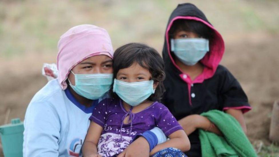 three children in masks