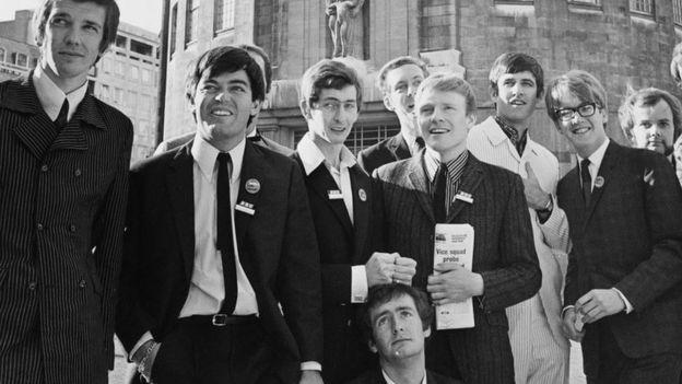Left to right; Pete Drummond, Tony Blackburn, Dave Cash, Kenny Everett (kneeling), Duncan Johnson, Chris Denning, Ed Stewart, Mike Ahern, John Peel.