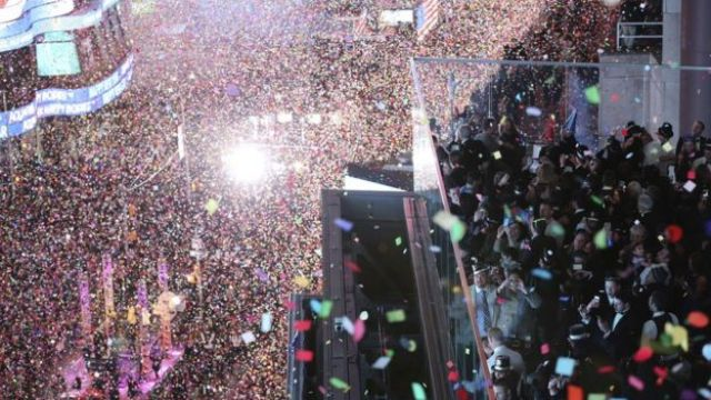 Revellers celebrate as confetti flies over New York