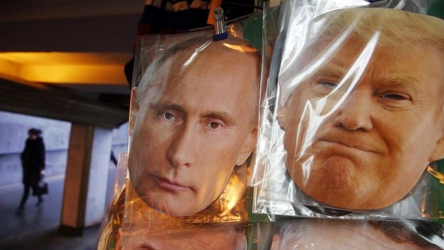 Masks of the two leaders sell on the streets of St Petersburg, Russia