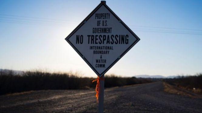 A sign warns against trespassing near the US/Mexico border in Presidio, Texas