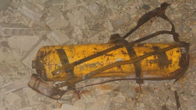 Handout photo provided to Reuters by Human Rights Watch purporting to show remnant of yellow gas cylinder found in Masaken Hanano, Aleppo, after a suspected chlorine attack on 18 November 2016