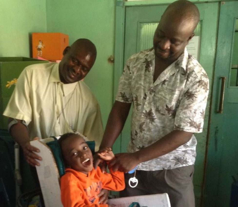 Kenneth Habaalu caring for a child