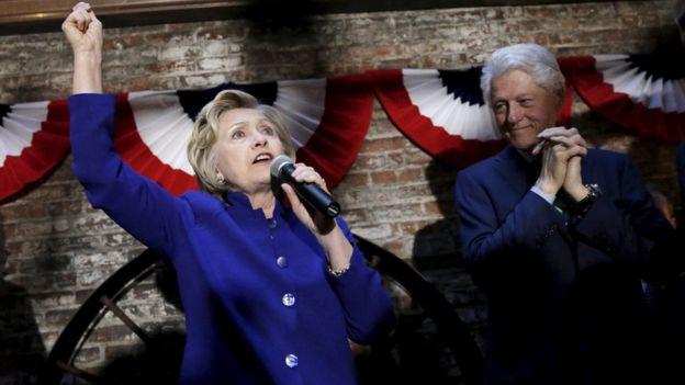 Democratic presidential hopeful Hillary Clinton alongside her husband, former US President Bill Clinton