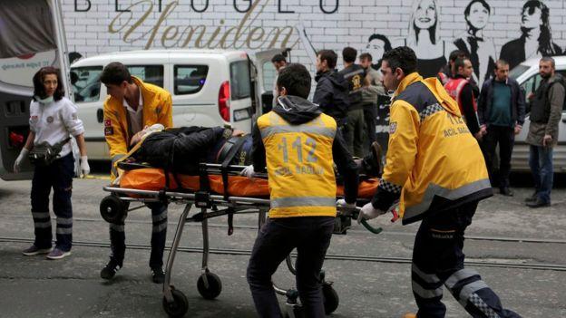 Injured being taken away