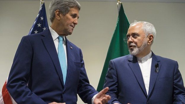 In this Saturday, Sept. 26, 2015 file photo, US Secretary of State John Kerry, left, meets with Iranian Foreign Minister Mohammad Javad Zarif at United Nations headquarters.