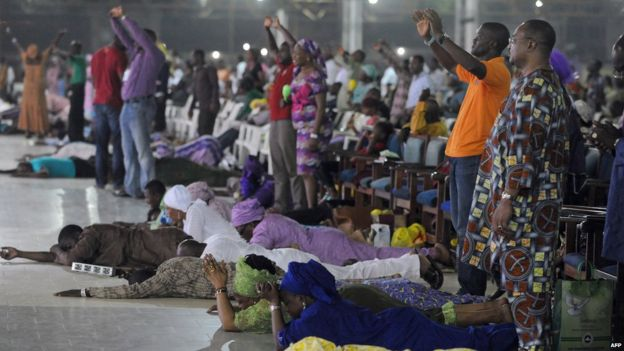 Worshippers pray into the New Year lying down during the crossover watch night church service at the Redemption Camp on Lagos Ibadan highway on 1 January , 2014.