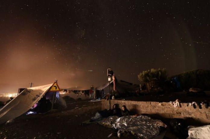 night sky stars, tents, people sleeping outdoors