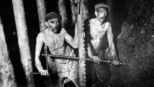 Two miners digging coal in 1924