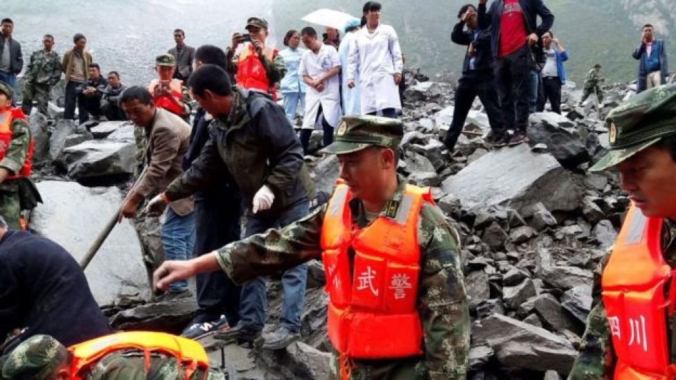 Rescue workers and medical staff search for survivors at landslide site in Xinmo village in Sichuan, southwest China, 24 June 2017