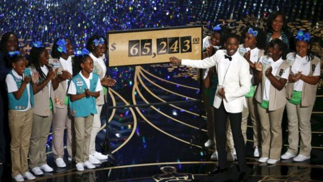 Chris Rock reveals that $65,243 USD was raised when Girls Scouts of the USA sold cookies to the Oscars audience