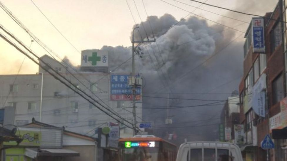Smoke rises from a burning hospital in Miryang, South Korea