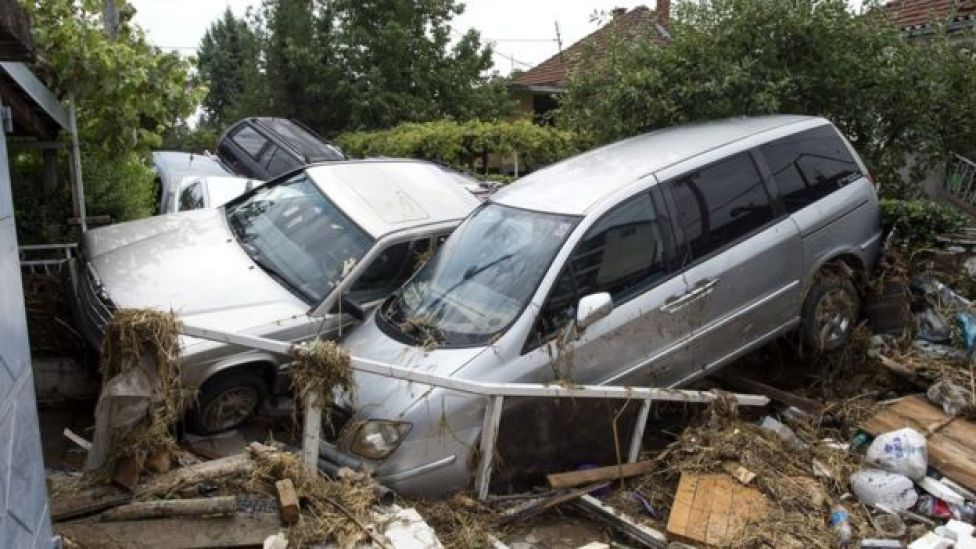 a pile of cars that has crashed together between some houses, 7 August 2016