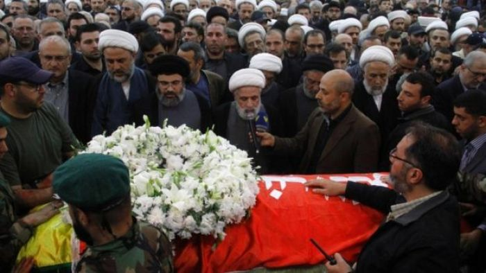 Hezbollah deputy leader Sheikh Naim Qassem (speaking) at the funeral on 12 May