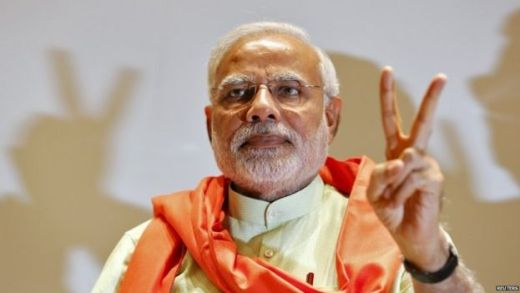Narendra Modi gestures upon his arrival to meet his party leaders and workers at Gandhinagar in the western Indian state of Gujarat in this May 13, 2014 file photo.