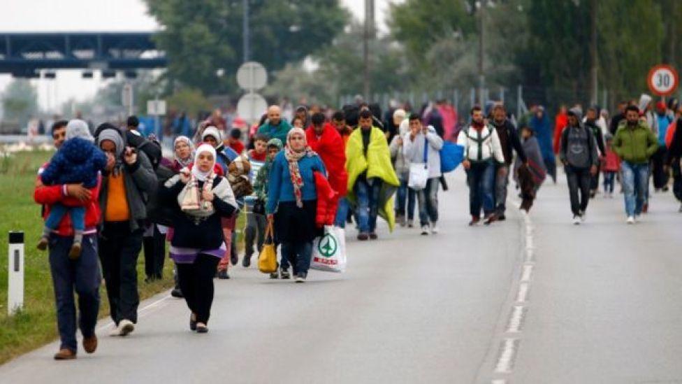 Migrants walk across the border at Nickelsdorf, Austria, 11 September 2011